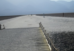 The Panamint Mountains loom  temptingly in the distance while I walk out onto the salt flats at Badwater