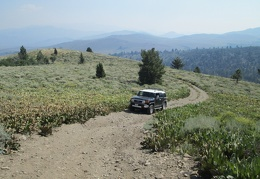 The FJ and I crawl up a little hill with really nice views of the mountains in the area