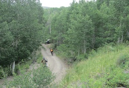 A group of several dirt bikers drives by after I pull over to check out a seep along the road