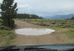 The mud at the bottom of this puddle turns out to be quite slippery as I drive though it
