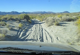 The FJ grinds and slides through a bit more sand further along the road