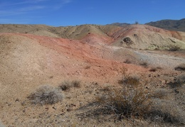 I pass more of that bright red soil on the way up the little hill