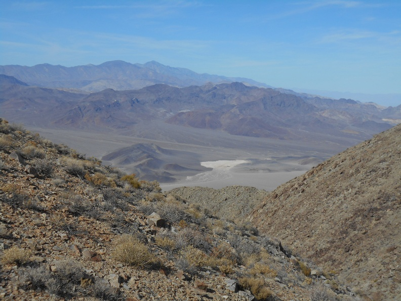 I climb up the next hill, looking down at Wingate Wash and the little dry lake