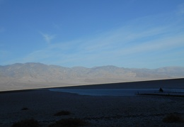 After packing up camp, the FJ drives past Badwater, which is still in the morning mountain shadow