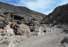 A few volcanic rocks fall down from the hills above