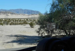 I drive across the railroad track and a sign welcomes me to Mojave National Preserve