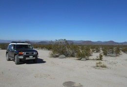 The FJ rises out of Jackass Canyon, overlooking the cinder cones of Mojave Preserve