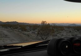 I sit in the FJ quietly, watching the sun go down