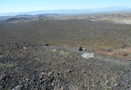 I enjoy looking at the greenish-black color of the lava bed below