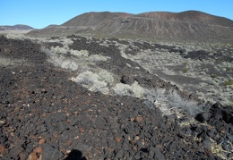 Hiking across that drainage down there with less lava might be easier