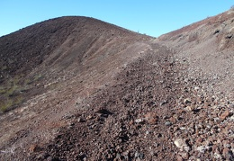 The old road rises toward the top of the cinder cone