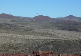 The low-flying airplane scans the cinder cones area