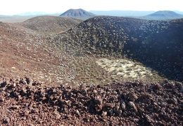 I can't stop looking at the juxtaposition of a tiny dry lake with cinder cones
