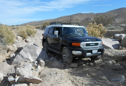 I get stuck in the loose rocks for a moment and use my rear differential locker for the first time