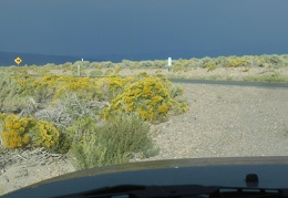 I watch dark cloud cover over toward Nevada as I remount Highway 120