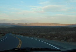 A fading sunset illuminates the Granite Mountains Wilderness as I drive Hwy 120
