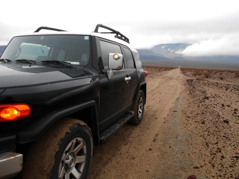 After a short distance on Nadeau Trail, the FJ tires are zero-traction and caked with mud