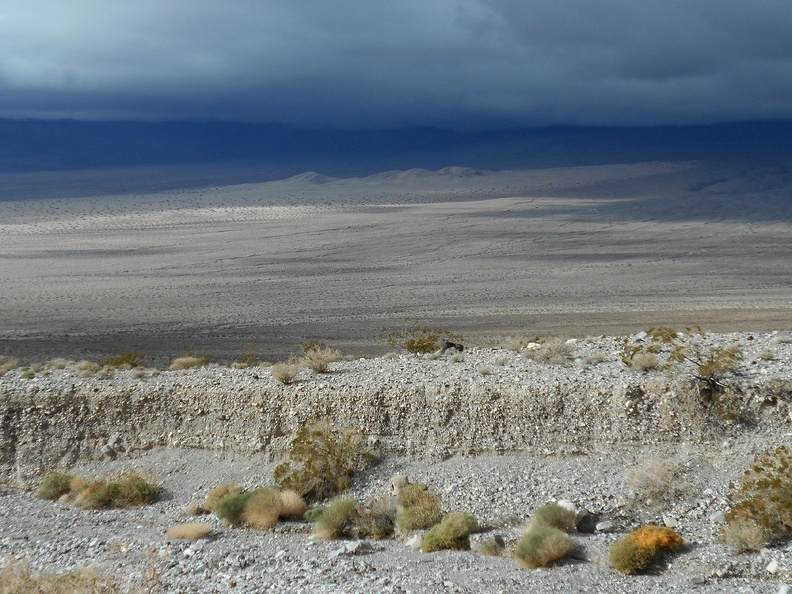 The sun tries to light up the Panamint Dunes over there