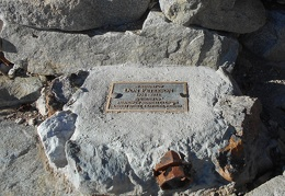 A small plaque remembers the founder of the Friends of the Minietta Cabin