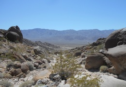 Boulders frame the views behind me down the wash to Saline Valley