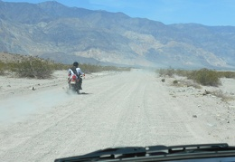 A dirt biker passes me on Saline Valley Road