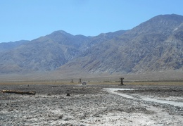 I walk back to the FJ and the salt-tram ruins against an Inyo Mountains backdrop