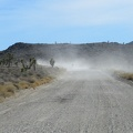 I follow the cloud of a dirt biker as I drive Saline Valley Road toward Lee Flat