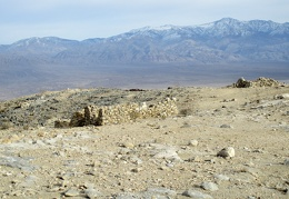 We arrive at some stone-cabin ruins overlooking Panamint Valley
