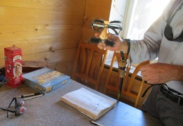 Glasses and moustache help the visitor to Osborne Cabin