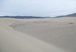 I'll follow this ring of sand around the valley-hole in the dunes