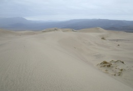 I put on my raincoat as I continue my walk on the Panamint Dunes
