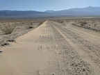 I drive past subtle sand drifts at the bottom of Minietta Road in Panamint Valley