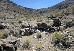 Rocks brought down from the hills may accumulate in a row