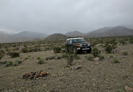 I see rain or snow in the Inyo Mountains behind my new campsite