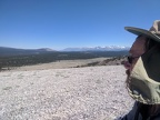 Sitting on gravel and looking down into Inyo National Forest