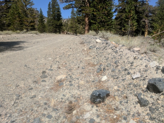 Obsidian plowed to the side of the road, my hike begins
