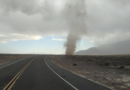 I start driving: is the dust devil in the middle of the road?