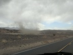 This dust devil is close to the road too