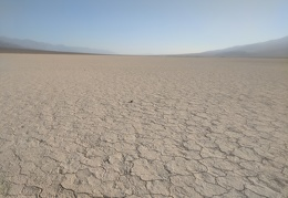 A loner rock rests out in the middle of Panamint Dry Lake