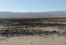 Rocks spill down from the Darwin Plateau onto Panamint Dry Lake
