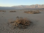 Panamint Dry Lake is slowly absorbed into the shadow of the Darwin Plateau