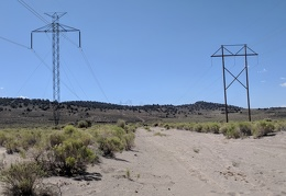 We cross the super-sandy powerline road