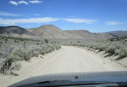 The descent from the Excelsior Mountains leads to a drive across Rattlesnake Flat