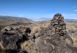 A big cairn atop the hill surprises me